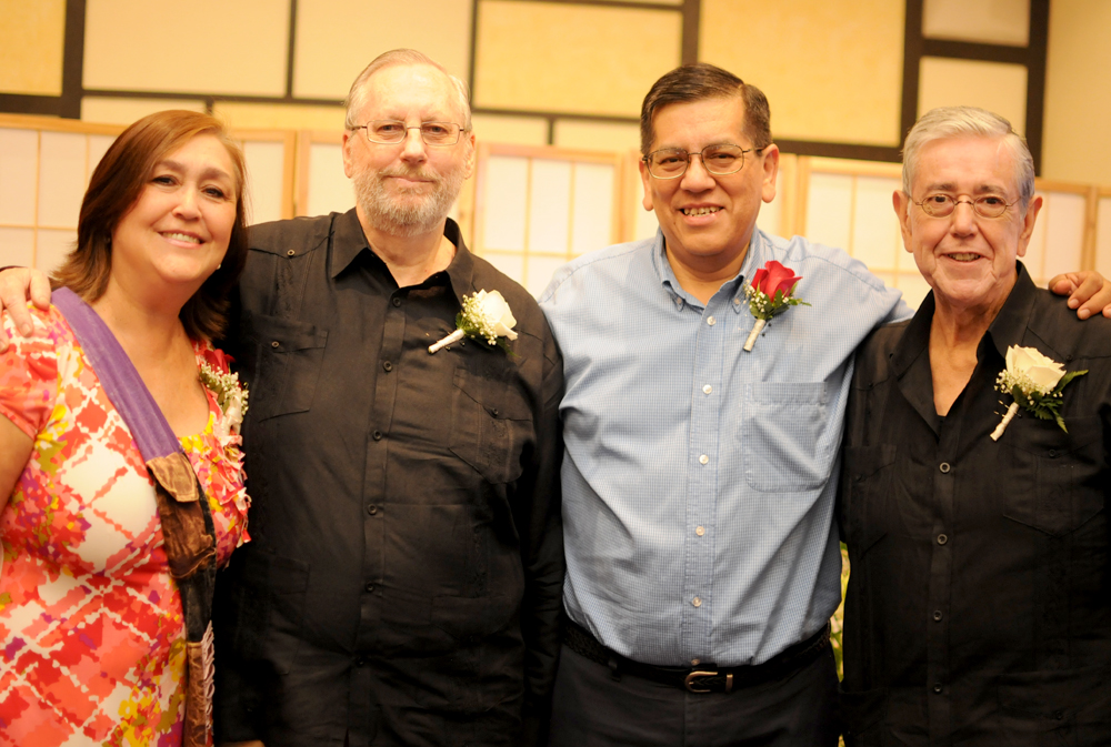 A couple pose with their family members after their church ceremony on  Saturday. Larry M Dahl and Gustavo Valadez-Ortiz have been together for 47  years.