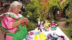 Amalia Martinez Delgado creates  Mazahuan dolls.