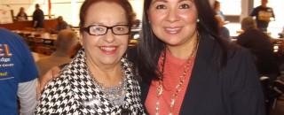 Hillary Clinton local campaign representative Choco Meza (standing left)