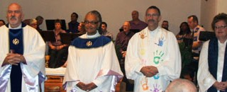 Rev. Mick Hinson (third from left) at his installation at MCC San Antonio in 2007. (Photo by Sam Sanchez)