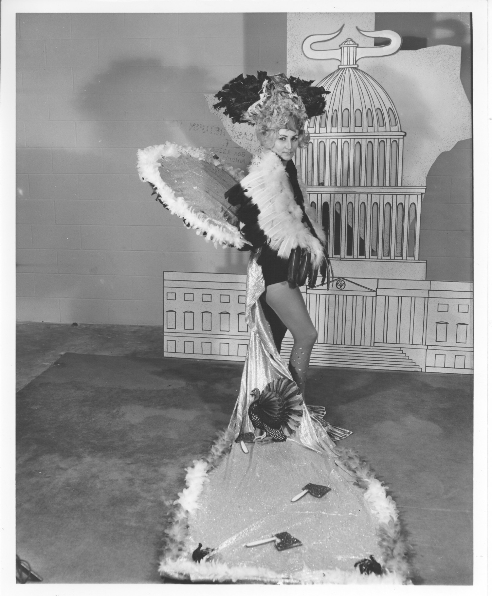 Aubrey Davenport as Duchess of the Turkey Trot, 1965. This costume demonstrates the trains that were common as a part of the costuming in the 1950s and 1960s . Courtesy of The Playhouse and the San Antonio Public Library Texana Collection.