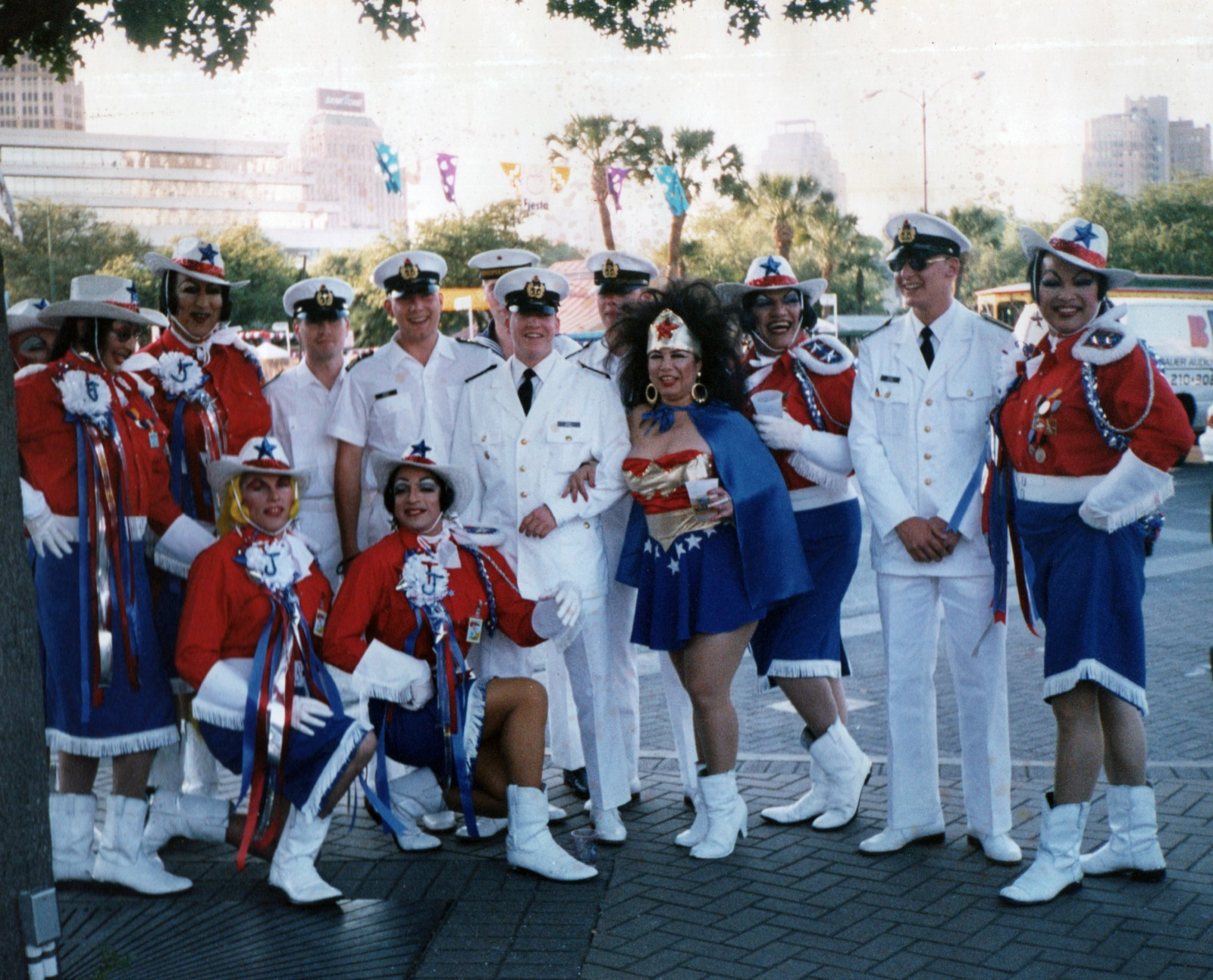 """Chicana Wonder Woman"" Lisa Suarez flanked by Cornyation cast members and Russian soldiers"