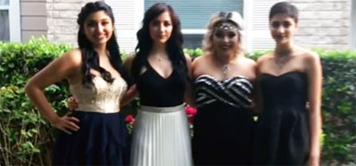 Jewel Uzquiano (second from left) and her friends pose for photo before Incarnate Word High School prom. (Video capture via WOAI)