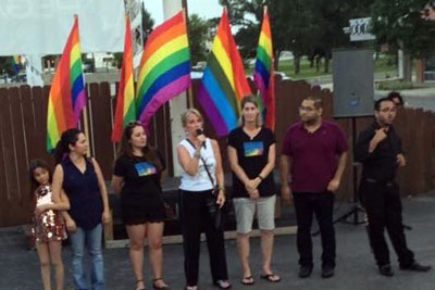 Community members speak during rally in the parking lot of Sparky's Pub (Photo: Facebook / Janet Burrage Grigsby)