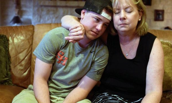 "Blair Hanner and his mom in the documentary, ""Becoming Blair."" (Video captures)"