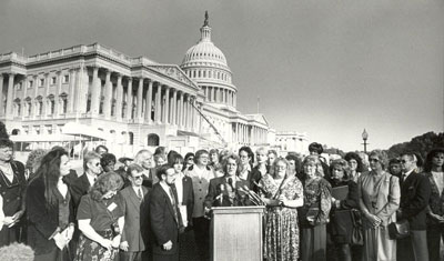 Phyllis Frye (standing at lectern) addresses the press at a national transgender lobby day in Washington, DC in 1996. (Courtesy photo)