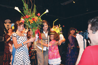 "Lisa Perello receiving flowers at her first flamenco fashion show ""Perello 09.13.12."" (Photo by Bryan Ryndfuss)"