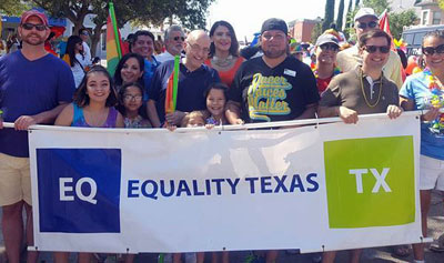 Robert Salcido (right of center in black t-shirt) with members of Equality Texas at the Austin Pride Parade. (Photo: Ignite Austin)
